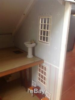 Antique dollhouse By FAO Schwarz in the 50's to the 60's. Big Size 38 X 22