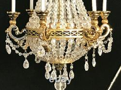 Artiasn made by Frank Crescente 6 arm Empire brass and crystal chandelier
