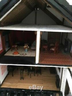 Beautiful Tudor style 8 rooms dolls house