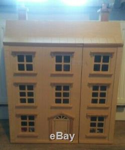 Classic four storey wooden dolls house with all furniture with people