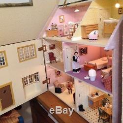 Dolls house, fully decorated and lit with full furnishings