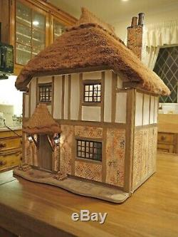 Exquisite and beautiful Hand Made Thatched Dolls House. (A Graham Wood Original)