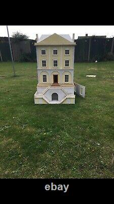 Large Wooden Dolls House With Dolls And Furniture
