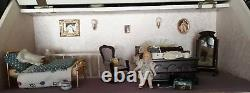 Large doll house with basement and accessories Good condition