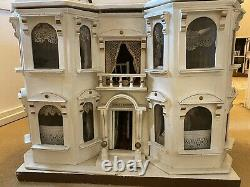 Matching pair of G & J Lines Bros fully furnished'Kits Coty' dolls houses c1910