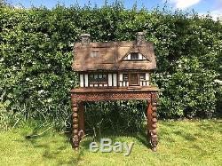 Stunning handmade, thatched country cottage dolls house
