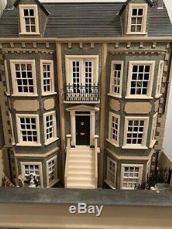 Unfinished large dolls house used 1/12
